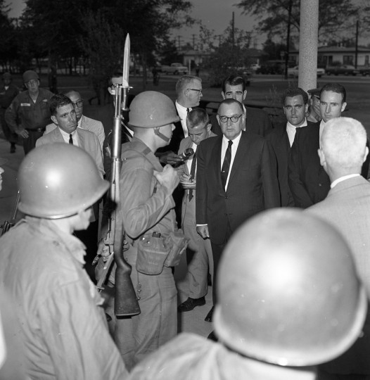 California Gov. Pat Brown is pictured with National Guardsmen at Will Rogers Memorial Park on Aug. 19, 1965. (Larry Sharkey/Los Angeles Times/TNS)