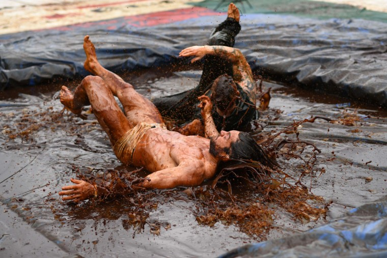 Competitors take part in the 8th annual World Gravy Wrestling Championships at the Rose n Bowl Pub in Bacup, north west England on August 31, 2015. Contestants must participate in fancy dress and wrestle in a pool of Lancashire Gravy for 2 minutes whilst being scored for a variety of wrestling moves. (OLI SCARFF/AFP/Getty Images)