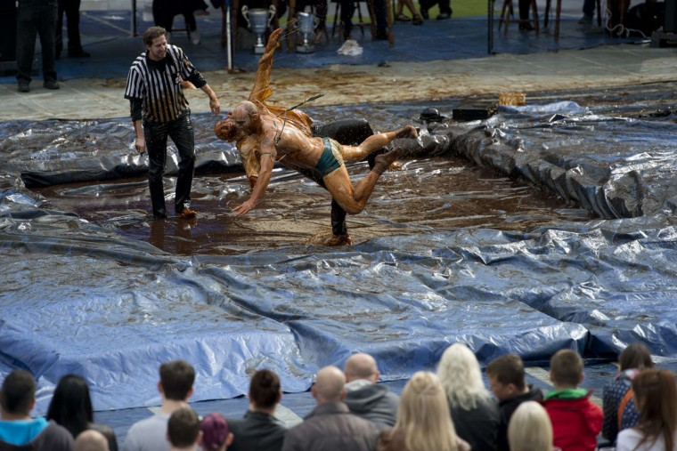 Competitors take part in the 8th annual World Gravy Wrestling Championships at the Rose n Bowl Pub in Bacup, north west England on August 31, 2015. (OLI SCARFFOLI SCARFF/AFP/Getty Images)