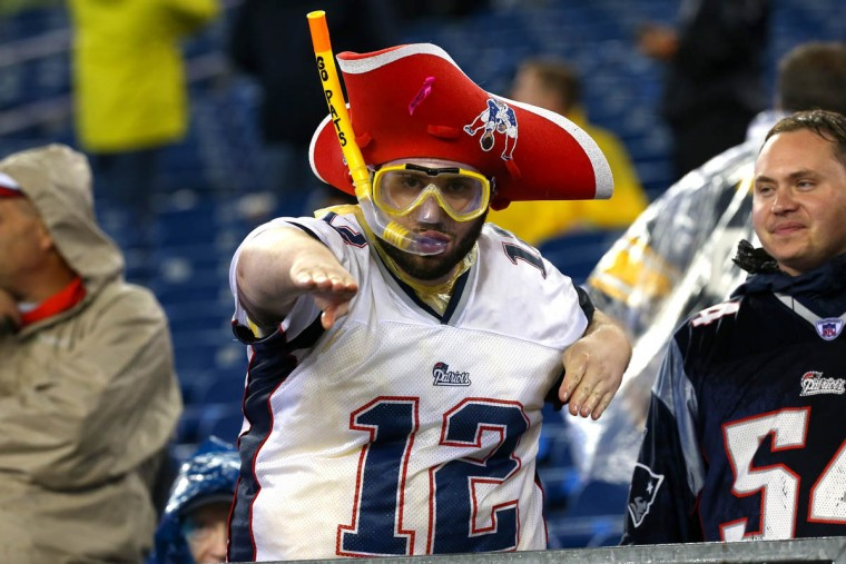 A New England Patriots fan looks on while wearing a snorkel in the rain before the game against the Pittsburgh Steelers at Gillette Stadium on September 10, 2015 in Foxboro, Massachusetts. (Jim Rogash/Getty Images)