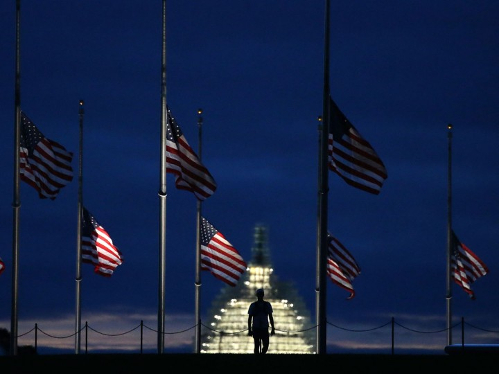 A man walks past a row of American flags that have been lowered to half staff on the Washington Monument grounds, near the US Capitol on September 11, 2015 in Washington, DC. Today marks the fourteenth anniversary of the September 11, 2001 attacks when terrorists high jacked airliners and flew them in the World Trade Center and the Pentagon. (Photo by Mark Wilson/Getty Images)