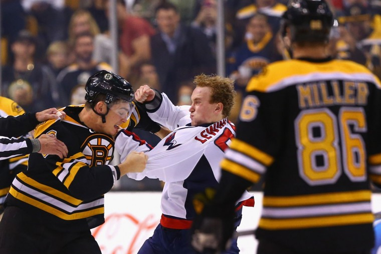 Tyler Lewington #78 of the Washington Capitals and Justin Hickman #60 of the Boston Bruins fight during the second period at TD Garden on September 22, 2015 in Boston, Massachusetts. (Photo by Maddie Meyer/Getty Images)