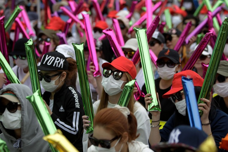 South Korean prostitutes hide their identities as they participate in a rally against anti-sex law on September 23, 2015 in Seoul, South Korea. Prostitutes rallied against government law aimed at the sex industry. The government began enforcing new laws eleven years ago to target human traffickers, pimps and prostitutes. Nearly seven years after tough laws began driving thousands of South Korean prostitutes out of business, sex workers of the red-light districts are fighting back, spurred by what they say is an unprecedented campaign of police harassment. (Photo by Chung Sung-Jun/Getty Images)