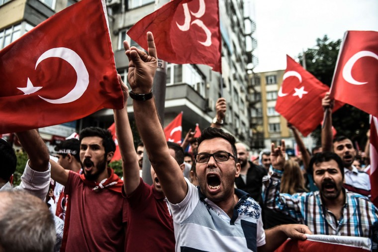 Turkish nationalists demonstrate against the Kurdish Workers Party (PKK) in Istanbul on September 8 ,2015. Turkish forces crossed into northern Iraq to pursue Kurdish militants on September 8 after the deadliest rebel attacks in years left dozens dead as the decades-long conflict escalated. Thirteen Turkish police were killed on September 8 in a new attack by PKK militants as violence in the east threatened to spiral out of control. That attack came two days after 16 Turkish soldiers were killed in a twin roadside bomb attack in Daglica in the southeastern Hakkari region, the army said, in the deadliest strike on troops in months. (AFP Photo/Ozan Kose)