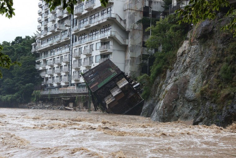 A hotel building falls into the floodwaters at Nikko mountain resort in Tochigi prefecture, north of Tokyo on September 10, 2015. Authorities in central Japan ordered tens of thousands to flee their homes after torrential rains flooded rivers and triggered landslides, with one person missing after a mudslide buried houses. The Japan Meteorological Agency issued special downpour warnings for Tochigi and Ibaraki prefectures, north of Tokyo, urging vigilance against mudslides and flooding. (AFP Photo/Jiji japan outjiji press)