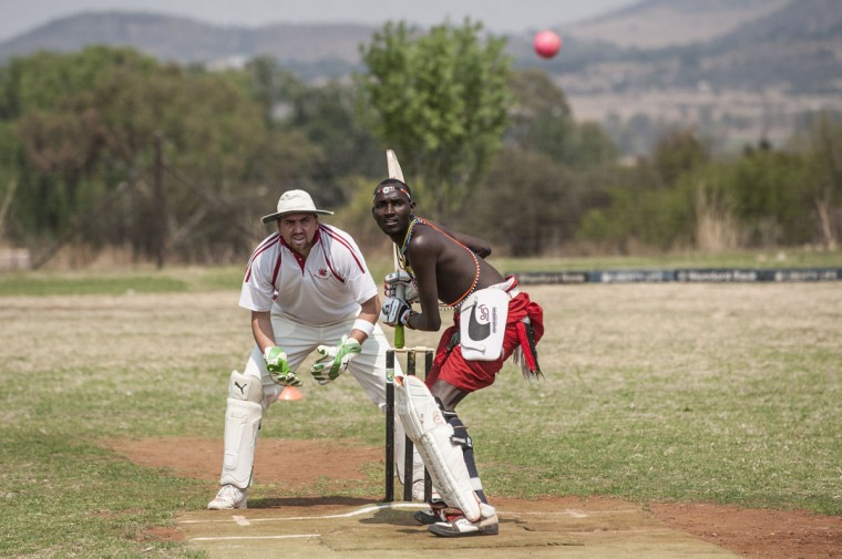 A Maasai Warriors cricket player gets ready to play a shot during a cricket match between Maasai Warriors and Glenvista Cricket Club invitational side at the Klipriviersberg Recreation Centre in Alberton on September 13, 2015. The Maasai Cricket Warriors, an ethnic group from Kenya, are visiting South Africa playing cricket to raise awareness for the fight against rhino poaching. In 2014, South Africa lost a record of 1,215 rhinos to illegal poaching. (AFP Photo/Stefan Heunis)