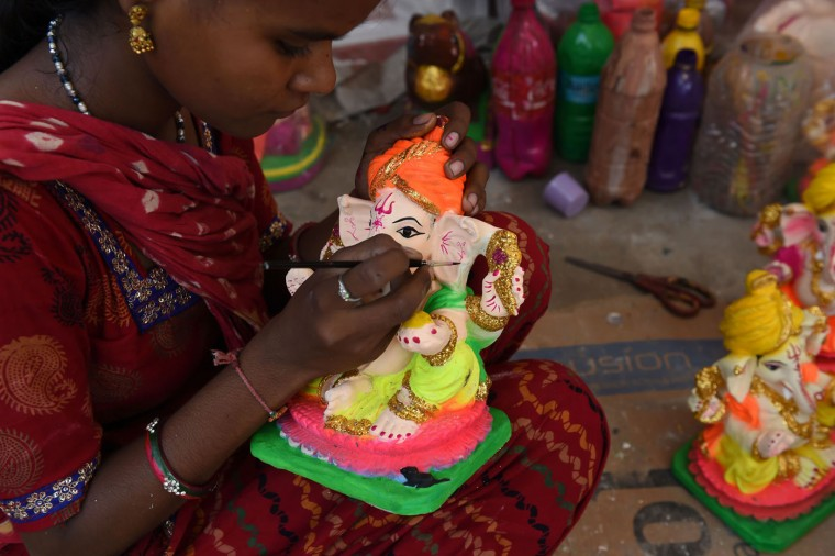 An Indian artist gives the finishing touches to a figure of the elephant-headed Hindu god Ganesha at a workshop ahead of the Ganesh Chaturthi festival in New Delhi on September 15, 2015. (Sajjad Hussain/AFP/Getty Images)