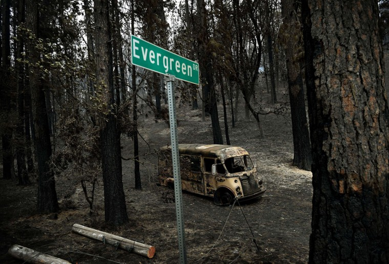 A general view shows a burned out vehicle on Evergreen Drive as firefighters continue to battle the Valley fire in the town of Cobb, California on September 15, 2015. The governor of California declared a state of emergency as raging wildfires spread in the northern part of the drought-ridden US state, forcing thousands to flee the flames. (AFP Photo/Mark Ralston)