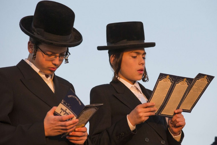 Ultra-Orthodox Jewish youths pray along the Mediterranean Sea in the Israeli city of Herzliya, near Tel Aviv, during the ritual of Tashlich on September 21, 2015. (JACK GUEZ/AFP/Getty Images)