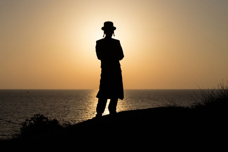 An ultra-Orthodox Jewish man prays along the Mediterranean Sea in the Israeli city of Herzliya, near Tel Aviv, during the ritual of Tashlich on September 21, 2015. (JACK GUEZ/AFP/Getty Images)