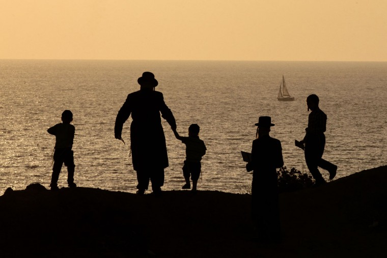 Ultra-Orthodox Jews pray along the Mediterranean Sea in the Israeli city of Herzliya, near Tel Aviv, during the ritual of Tashlich on September 21, 2015. (JACK GUEZ/AFP/Getty Images)