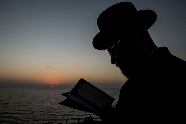 An ultra-Orthodox Jewish man prays along the Mediterranean Sea in the city of Herzliya, near Tel Aviv, during the ritual of Tashlich on September 21, 2015. (JACK GUEZ/AFP/Getty Images)
