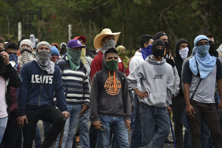 Student teachers from Ayotzinapa angry for the disappearance of 43 students are pictured during clashes with the riot police along the Tixtla-Chilpancingo highway in Tixtla, Guerrero State, Mexico, on September 22, 2015. (YURI CORTEZ/AFP/Getty Images)