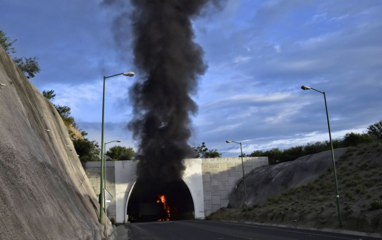 A truck set ablaze during clashes between student teachers from Ayotzinapa angry for the disappearance of 43 students and the riot police burns in flames in a tunnel along the Tixtla-Chilpancingo highway in Tixtla, Guerrero State, Mexico, on September 22, 2015. (YURI CORTEZ/AFP/Getty Images)