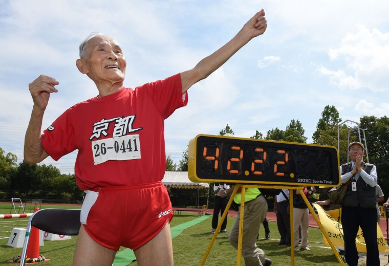 Hidekichi Miyazaki (in red), 105, imitates the pose of Usain Bolt after running with other competitors over eighty years of age during a 100-metre-dash in the Kyoto Masters Autumn Competiton in Kyoto, western Japan, on September 23, 2015. Miyazaki was authorised as the oldest sprinter who competed in a 100-metre-dash by the Guinness World Records. (AFP Photo/Toru Yamanaka)