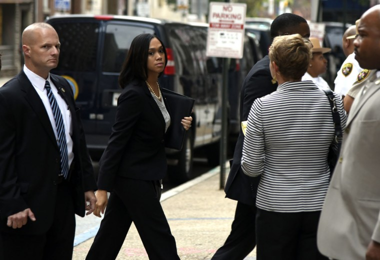 Baltimore State Attorney Marilyn Mosby walks into a side door of the Baltimore Circuit Court on Thursday, Sept. 10, 2015 in Baltimore. The trials for six police officers charged in the arrest and death of Freddie Gray will be held in Baltimore, Circuit Court Judge Barry Williams ruled, saying it would be nearly impossible to find a place not inundated by publicity about the high-profile. (Barbara Haddock Taylor/The Baltimore Sun via AP)