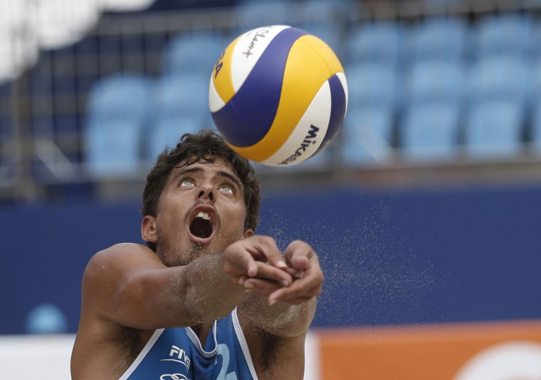 Brazil's Daniel Lustosa returns the ball during a FIVB Beach Volleyball World Tour qualification game against Canada on Copacabana beach in Rio de Janeiro, Brazil, Wednesday, Sept. 2, 2015. The tournament is one of various test events ahead of Rio's 2016 Olympic games. (AP Photo/Silvia Izquierdo)