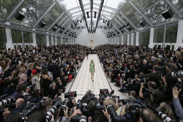 A model wears an outfit during the Spring/Summer 2016 Burberry show for London Fashion Week at Kensington Gardens, London, Monday Sept. 21, 2015. (AP Photo/Tim Ireland)