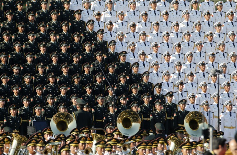 A military band performs prior to the start of a parade commemorating the 70th anniversary of Japan's surrender during World War II held in front of Tiananmen Gate in Beijing, Thursday, Sept. 3, 2015. (AP Photo/Ng Han Guan)