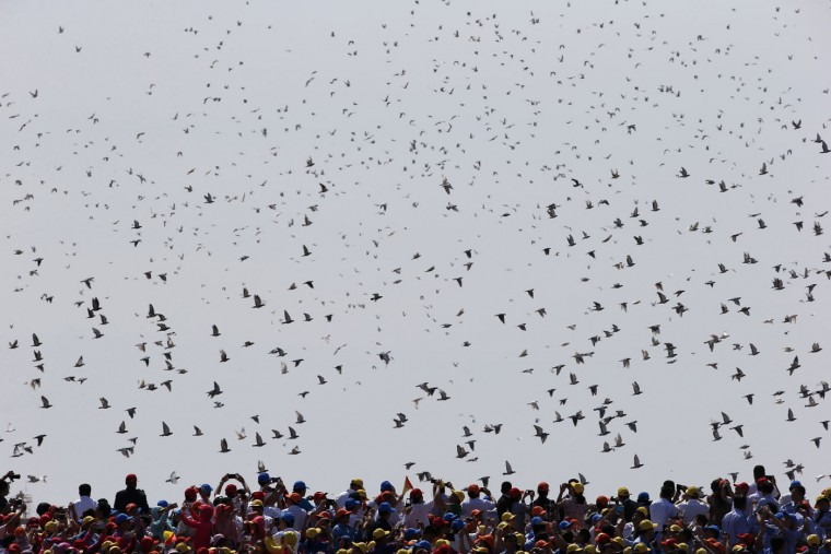 Thousands of doves are released during a parade commemorating the 70th anniversary of Japan's surrender during World War II held in front of Tiananmen Gate, in Beijing, Thursday, Sept. 3, 2015. The spectacle involved more than 12,000 troops, 500 pieces of military hardware and 200 aircrafts of various types, representing what military officials say is the Chinese military's most cutting-edge technology. (AP Photo/Ng Han Guan)