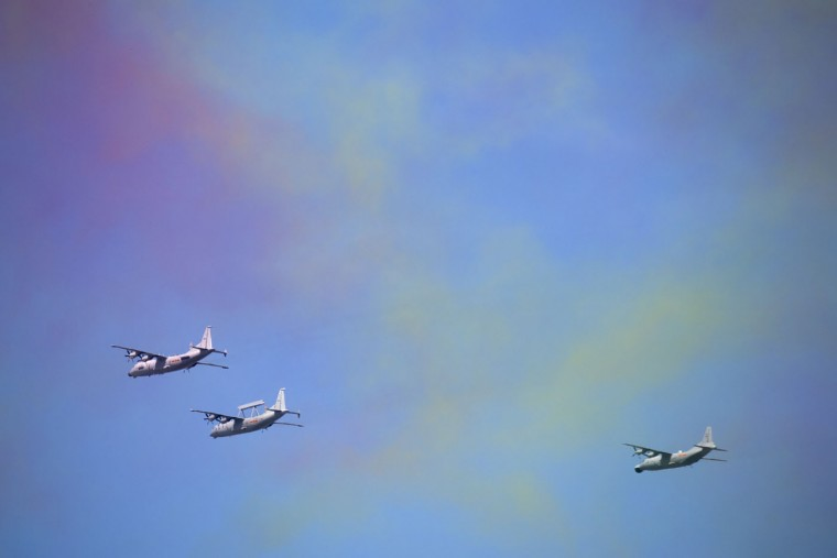 Chinese Y-8 military radar planes fly past colored smoke during a parade commemorating the 70th anniversary of Japan's surrender during World War II in Beijing, Thursday, Sept. 3, 2015. The spectacle involved more than 12,000 troops, 500 pieces of military hardware and 200 aircraft of various types, representing what military officials say is the Chinese military's most cutting-edge technology. (AP Photo/Mark Schiefelbein)