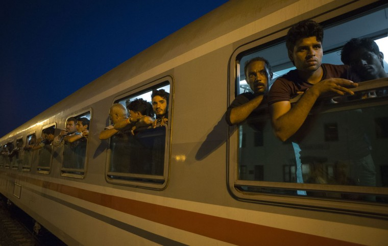 Migrants arrive at the train station in Beli Manastir, near Hungarian border, northeast Croatia, Thursday, Sept. 17, 2015. Croatia has suddenly become the latest hotspot in the 1,000-mile plus exodus toward Western Europe after Hungary sealed off its border Tuesday with a razor-wire fence and then used tear gas, batons and water cannons to keep the migrants out. (AP Photo/Darko Bandic)
