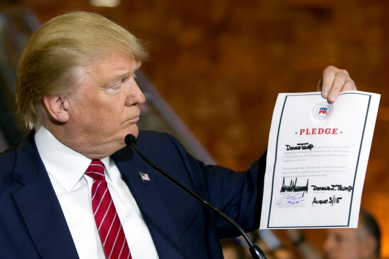 Republican presidential candidate Donald Trump looks at a signed pledge during a news conference in Trump Tower, Thursday, Sept. 3, 2015 in New York. Trump ruled out the prospect of a third-party White House bid and vowed to support the Republican Party's nominee, whoever it may be. (AP Photo/Richard Drew)