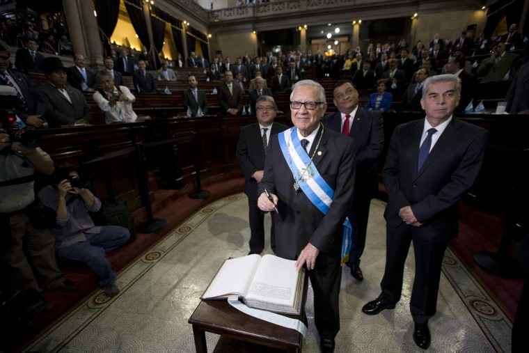 Guatemala's new President Alejandro Maldonado attends his swearing-in ceremony before Congress in Guatemala City, Thursday, Sept. 3, 2015. Maldonado was sworn in amid a corruption scandal that has caused a national political crisis. The conservative former judge will serve out the term of ex-President Otto Perez Molina, who resigned late Wednesday after a judge issued an order for this detention. Prosecutors accuse the ex-president of leading a customs fraud ring. (AP Photo/Moises Castillo)