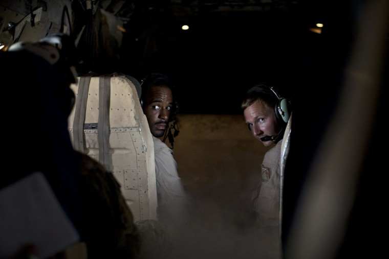 Members of a cargo aircraft crew perform a visual check of their passengers as their plane prepares to land on the USS Theodore Roosevelt aircraft carrier currently deployed in the Persian Gulf, supporting Operation Inherent Resolve, the military operation against Islamic Stare extremists in Syria and Iraq. (AP Photo/Marko Drobnjakovic)
