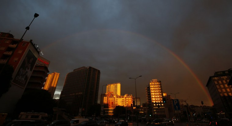 A rainbow stretches across the Milan skyline, Italy, after heavy rain, Wednesday, Sept. 23, 2015. (AP Photo/Luca Bruno)