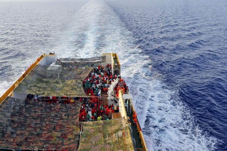 Migrants crowd the bridge of the Norwegian Siem Pilot ship sailing along the Mediterranean sea, Wednesday, Sept. 2, 2015. The Siem Pilot is carrying to the Italian Port of Cagliari hundreds of migrants rescued in several operations in the Mediterranean sea. (AP Photo/Gregorio Borgia)