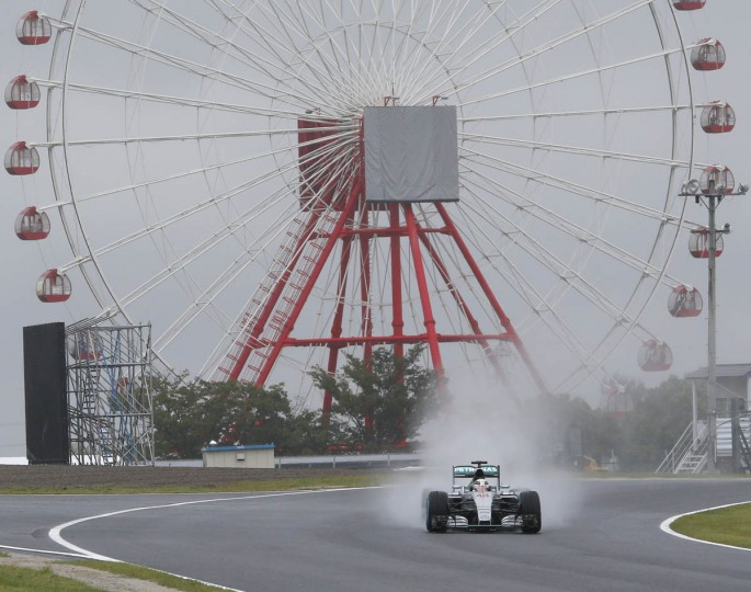 Mercedes driver Lewis Hamilton of Britain steers his car during the first practice session for the Japanese Formula One Grand Prix at the Suzuka Circuit in Suzuka, central Japan, Friday, Sept. 25, 2015. (Toru Takahashi/AP photo)