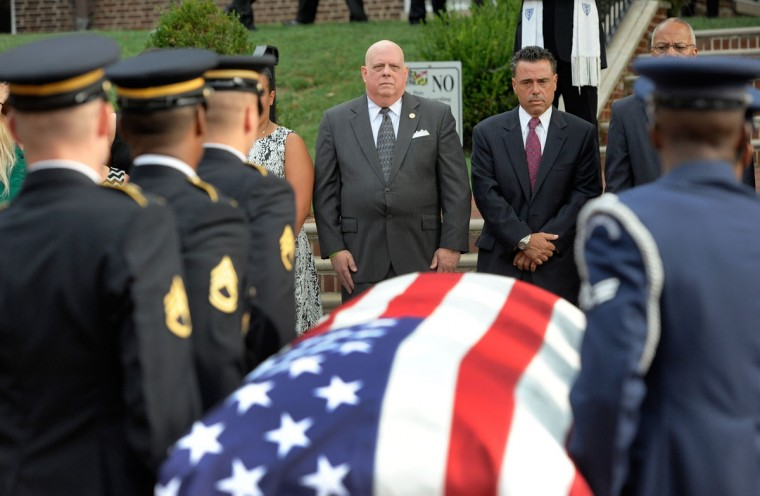 Maryland Gov. Larry Hogan, center left, Paul Dorsey, center right, son of former Maryland Gov. Marvin Mandel, stand as an honor guard carries the former governor's casket to lie in repose at the Maryland State House, Wednesday, Sept. 2, 2015, in Annapolis, Md. Mandel, a Democrat who served as governor from 1969 to 1979, died Sunday, Aug. 30, 2015. He was 95. (AP Photo/Steve Ruark)