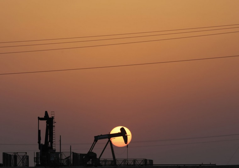 An oil pump works at sunset Wednesday, Sept. 30, 2015, in the desert oil fields of Sakhir, Bahrain. Consumer prices across the 19-country eurozone fell in September for the first time in half a year as energy prices tanked, official figures showed Wednesday in a development that's likely to ratchet up pressure on the European Central Bank to give the region another dose of stimulus. (AP Photo/Hasan Jamali)