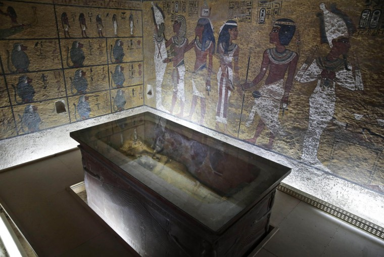 The tomb of King Tut is displayed in a glass case at the Valley of the Kings in Luxor, Egypt, Tuesday, Sept. 29, 2015. Egypt's antiquities minister said King Tut's tomb may contain hidden chambers, lending support to a British Egyptologist's theory that a queen may be buried in the walls of the 3,300 year-old pharaonic mausoleum. (AP Photo/Nariman El-Mofty)