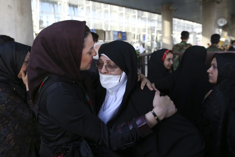 A female Iranian hajj pilgrim is welcomed by her daughter upon arrival at the Tehran Imam Khomeini airport, Iran, Tuesday, Sept. 29, 2015. More than 700 pilgrims were killed on Thursday in a stampede during the final days of the annual hajj in Mina near the holy city of Mecca, Saudi Arabia. The disaster killed at least 239 Iranian pilgrims, while over 200 people remain missing, Iran's state television reported. (AP Photo/Vahid Salemi)
