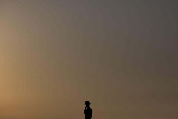 "An ultra-Orthodox Jewish man of the Hassidic sect Vizhnitz prays on a hill overlooking the Mediterranean Sea as they participate in a Tashlich ceremony in Herzeliya, Israel, Monday, Sept. 21, 2015. Tashlich, which means ""to cast away"" in Hebrew, is a practice in which Jews go to a large flowing body of water and symbolically ""throw away"" their sins by throwing a piece of bread, or similar food, into the water before the Jewish holiday of Yom Kippur, which start on Tuesday at sundown. (AP Photo/Ariel Schalit)"