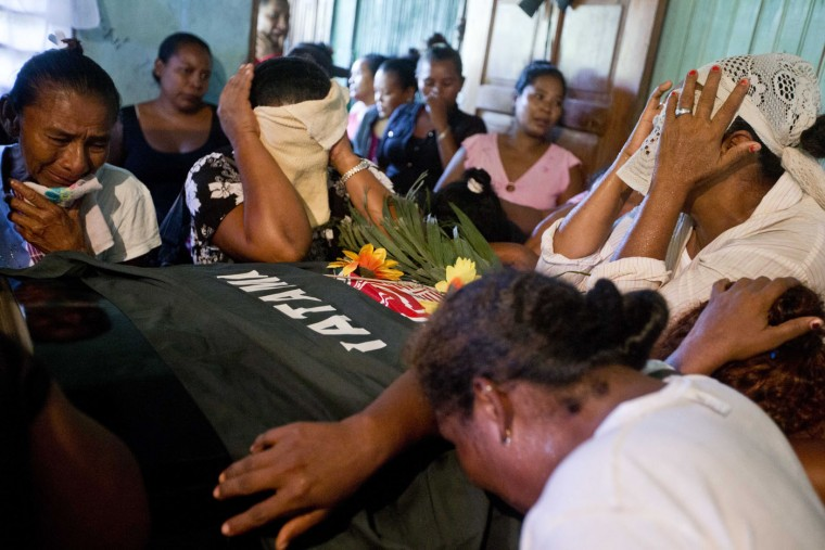 Relatives of Mario Leman, leader of the Miskito political party YATAMA, mourn during Leman's wake in the Caribbean coastal town Waspam, Nicaragua, Thursday, Sept. 17, 2015. Leman was killed during a recent clash between a group of Sandinistas and YATAMA members. The Miskito indigenous people say tensions began when they began expelling squatters who had occupied parts of their land. (AP Photo/Esteban Felix)