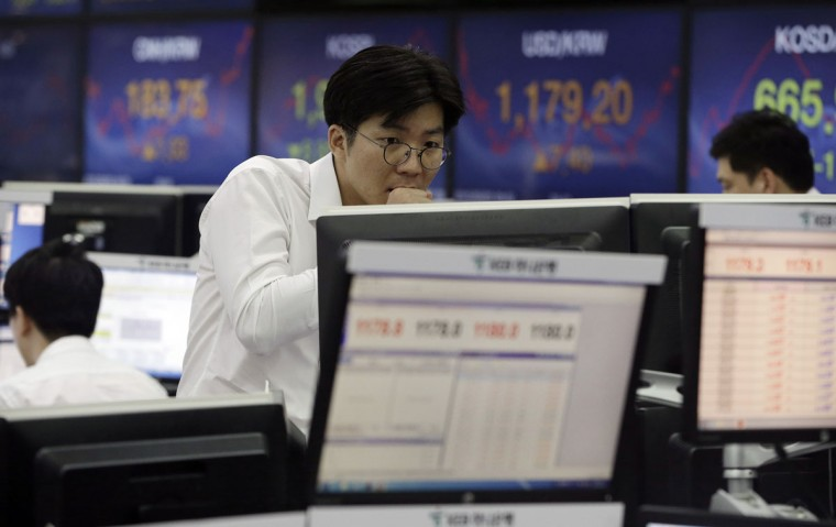 A currency trader watches monitors at the foreign exchange dealing room of the KEB Hana Bank headquarters in Seoul, South Korea, Wednesday, Sept. 2, 2015. Asian stocks extended a global market sell-off Wednesday as poor manufacturing data from the world's two biggest economies dampened investor sentiment. (AP Photo/Ahn Young-joon)