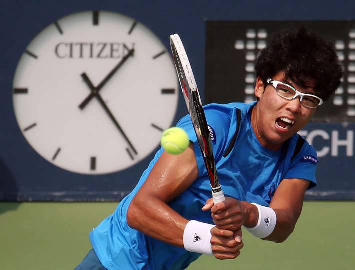 Hyeon Chung, of South Korea, returns a shot to Stan Wawrinka, of Switzerland, during the second round of the U.S. Open tennis tournament, Thursday, Sept. 3, 2015, in New York. (AP Photo/Adam Hunger)