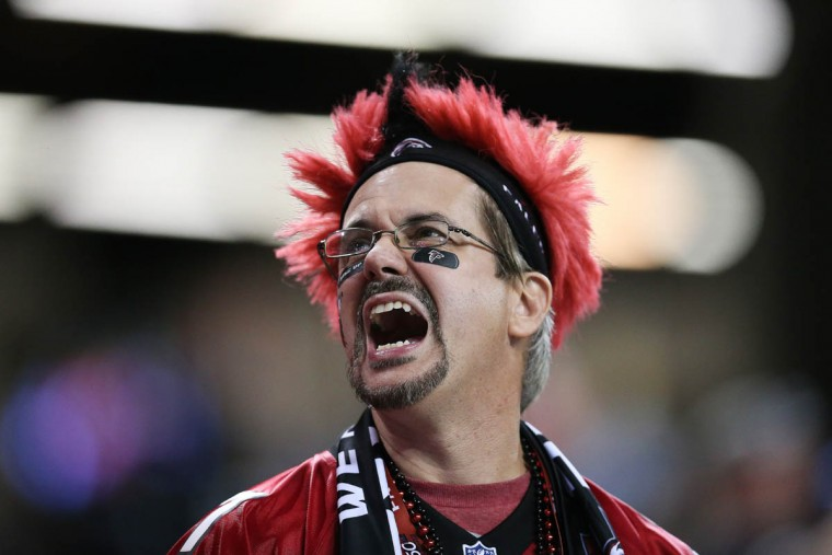 An Atlanta Falcons fan cheers against the Philadelphia Eagles during the first half of an NFL football game, Monday, Sept. 14, 2015, in Atlanta. (John Bazemore/AP photo)