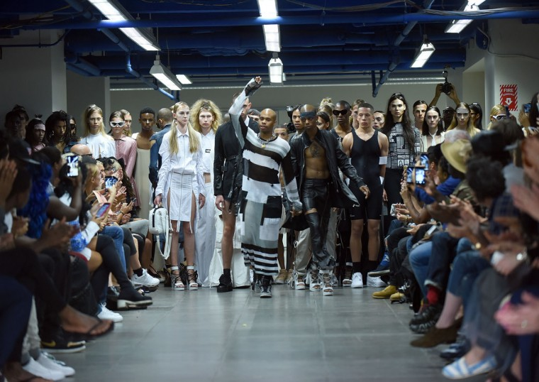 Designer Shayne Oliver, center, greets the audience after his Hood by Air Spring 2016 collection is modeled during Fashion Week, Sunday, Sept. 13, 2015, in New York. (AP Photo/Diane Bondareff)