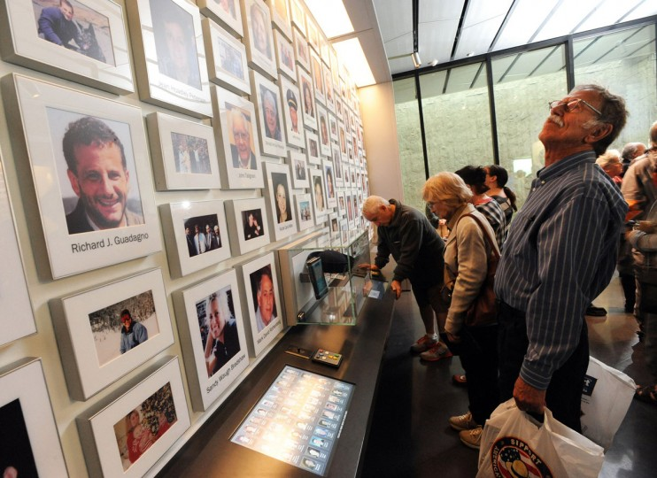 Jan Duncan and her fiance Rege Windisch of Freedom, Pa., look over the victim's photo display at the new Flight 93 National Memorial Visitor Center in Shanksville, Pa., Thursday, Sept. 10, 2015. Sitting on a hill overlooking the crash site near Shanksville, the $26 million visitor center complex opened to the public on Thursday, one day before the annual 9/11 observances in Pennsylvania, New York and Washington. (John Rucosky/The Tribune-Democrat via AP)