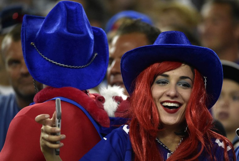 A New York Giants fan watches action against the Dallas Cowboys during the second half of an NFL football game Sunday, Sept. 13, 2015, in Arlington, Texas. (Michael Ainsworth/AP photo)