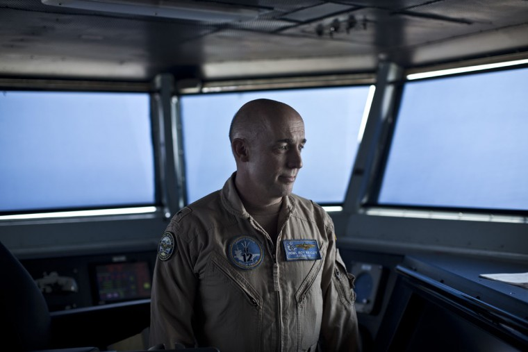Rear Admiral Roy Kelley, the Commander of Carrier Strike Group 12, stands inside the Flag Bridge on board the USS Theodore Roosevelt, a Nimitz class nuclear powered aircraft carrier currently deployed in the Persian Gulf, supporting Operation Inherent Resolve, the military operation against Islamic State extremists in Syria and Iraq. (AP Photo/Marko Drobnjakovic)
