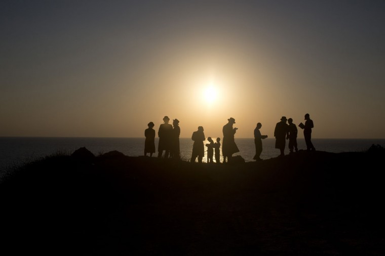 Ultra-Orthodox Jews of the Hassidic sect Vizhnitz pray on a hill overlooking the Mediterranean Sea as they participate in a Tashlich ceremony in Herzeliya, Israel, Monday, Sept. 21, 2015. (AP Photo/Ariel Schalit)