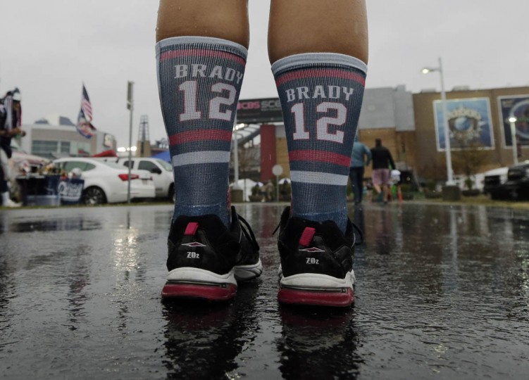 A New England Patriots fan wears socks supporting New England Patriots quarterback Tom Brady as she arrives for an NFL football game against the Pittsburgh Steelers, Thursday, Sept. 10, 2015, in Foxborough, Mass. (Charles Krupa/AP photo)