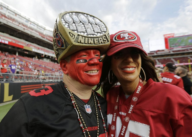 San Francisco 49ers fans Mark Castanon, left, and Kathy Hughes stand on the field at Levi's Stadium before an NFL football game between the San Francisco 49ers and the Minnesota Vikings in Santa Clara, Calif., Monday, Sept. 14, 2015. (Eric Risberg/AP photo)
