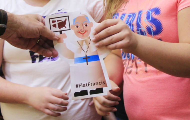 "A ""Flat Francis"" is given to students at Holy Angels School Friday, Sep. 25, 2015 in West Bend, Wis. (John Ehlke/West Bend Daily News via AP)"