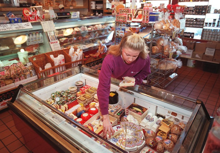 January 5, 1996--Theressia Hein owns and manages Old World Gourmet at Belvedere Square Market. (Perry Thorsvik/Baltimore Sun)